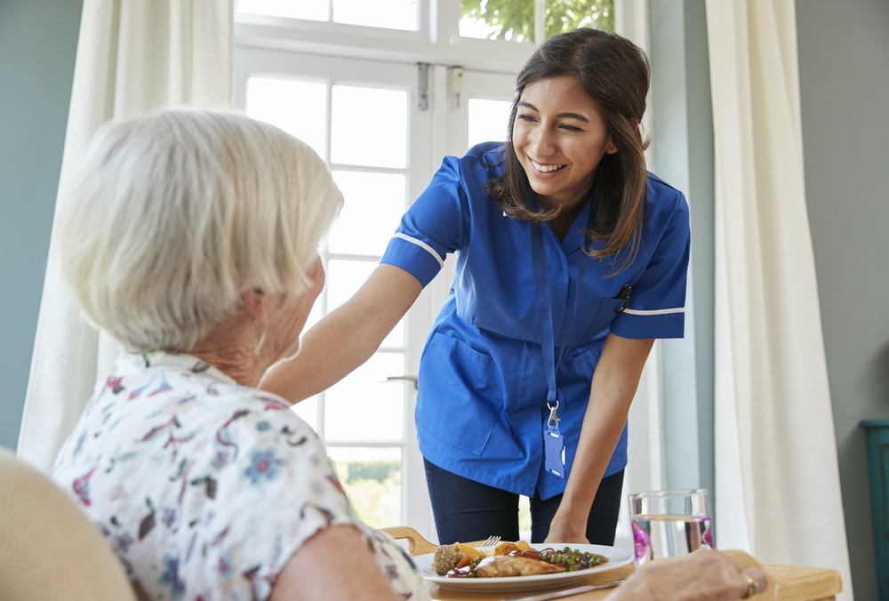 Caregiver working directly with senior